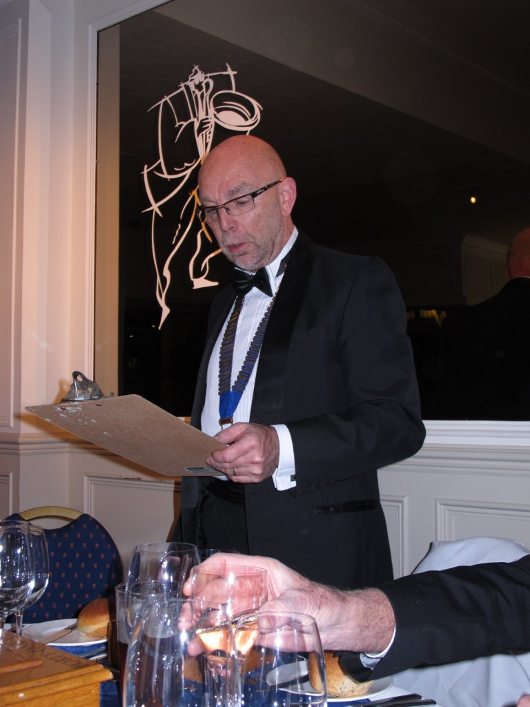 The Chairman pretends to be in charge whilst somebody snaffles his wine