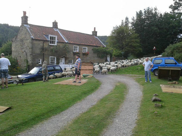 Quoits in action (?) whilst the local ladies come to watch